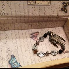 Handmade bracelet Handmade sparrow bracelet with black,silver, and bronze colored beads Nameless Creations Jewelry Bracelets
