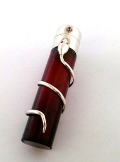 ANTIQUE CRANBERRY GLASS AND SOLID SILVER SERPENT SCENT BOTTLE - ASSAYED BIRMINGHAM 1899.