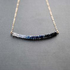 This beautiful necklace features faceted natural sapphire beads (approx. 3mm) in an ombre pattern. The row of beads measures approximately 2 inches across. All materials are high quality sterling silver or 14K gold filled. Choose your finish and length from the drop down menus.  The