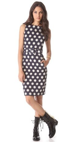 1,475.00  Polka-dot pointelle composes this retro sheath dress by Moschino, putting a cheerful spin on the chic silhouette. The optional self-belt buckles at the waist