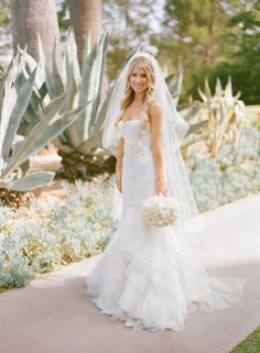 a Bride looking gorgeous in http://www.verawang.com/, Floral Design By / nisiesenchanted.com