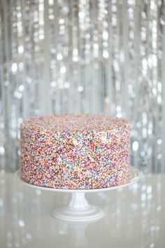 Bright AND fun sprinkle cake. Add some color to your New Years or any party