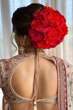 Wish to pair exotic flowers with your unique colour lehenga on your wedding. Check this bride's pastel colour lehenga styled with stunning red carnations bun.    #Indianweddings #shaadisaga #indianbridalhairstyles #hairstyleswithflowers #intimatewedding #realflowers #uniquecolourlehenga #babybreaths #lowbun  #exoticflowerhairstyle #carnations Simple Bridal Hairstyle, Indian Bridal Hairstyles, Try On Hairstyles, Metallic Blouses, Lehenga Style, Blouse Neck Designs, Hair Styles, Stylish, Exotic Flowers