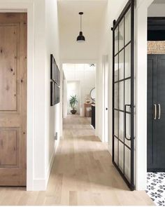 The most gorgeous hallway inspo with white oak floors and sliding French doors v… – Decor Home Sliding French Doors, Double Doors, Solid Doors, Hill Interiors, Interior Barn Doors, Interior French Doors, Black Trim Interior, White Walls, White Hallway