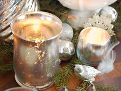 """How to Make Mercury Glass Votives. Transform inexpensive glass votives and hurricanes into faux """"mercury glass"""" candle holders using silver and gold leaf. These chic, handmade accessories will bring a little shine to any Christmas arrangement. Elegant Christmas Decor, Diy Christmas Decorations Easy, Handmade Christmas, Christmas Crafts, Christmas Ornaments, Xmas, Cheap Christmas, Magical Christmas, Christmas Wreaths"""