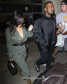 Kim Kardashian Photos Photos - Couple Kanye West and Kim Kardashian are seen arriving on a flight at LAX airport in Los Angeles, California on May Kim and Kanye are returning from London where they attended The Vogue Anniversary Gala Dinner. Yeezy Boost 550, Yeezy Boost 350 Black, Kardashian Photos, Kim Kardashian, Running Pose, Kanye West And Kim, Running Inspiration, Gala Dinner, Fresh Kicks