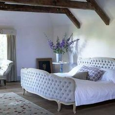 Love the tufted bed!