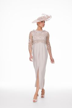 Beautiful blush dress and guipere lace top with a rolled satin collar. The clever pleating in this dress flatters all shapes leaving you to feel comfortable and look elegant at all times from angles! The beauty that is the guipere lace has been added to the matching hat that is also individually made to order @joyceyoungdesignstudio