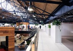 Historic Goods Shed Revamped into a Vibrant Warehouse Workplace