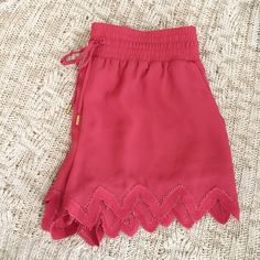 Crochet Trim Shorts size S Cute salmon color, 100% polyester shell and lining is 5% spandex and polyester. New with tags. Fits larger than a small. A Medium can fit into the shorts as well. bebe Shorts Skorts