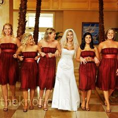 The five bridesmaids wore knee-length chiffon dresses in burgundy. the style was a good match for the wedding's modern, romantic vibe.