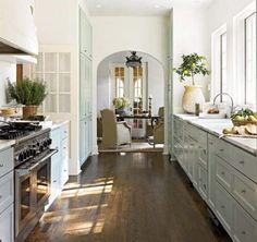 Kitchen with cottage charm. Love the profile of the drawer fronts.