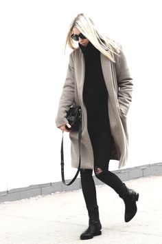If you're looking for something to wear as summer becomes fall, ripped skinnies and sweater under a long coat are just what you need. Via figtnyCoat: Oak & Fort, Skinnies: Zara, Sweater: Aritzia Knit, Boots: Alexander Wang