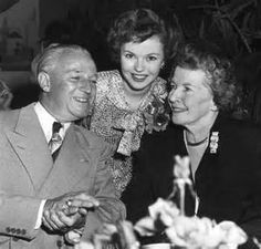 Shirley Temple with her parents in 1949.
