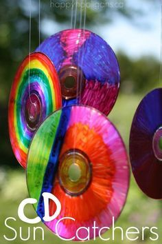 Vibrant CD Sun Catchers!  Great upcycle for the kids!  Turn your old cds into sun catchers.  Hang them from a tree or on your deck, patio or balcony! - Happy Hooligans