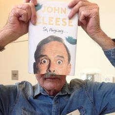 "Today's #bookfacefriday belongs to John Cleese's new book ""So, Anyway..."" Shout out to John, one of our circulation pages, for being our #bookface model! @nypl #syosset #library #johncleese #newbooks #books #reading #nypl #nonfiction #biography #memior #syossetbookface"