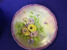 Gary C Collins painted porcelain pansies.