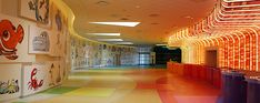 """Art of Animation Resort Lobby with new check-in """"grocery lane"""" style."""
