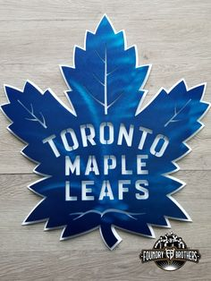 Toronto Maples Leafs Metal Sign by Foundry Brothers - Metal Art Toronto Maple Leafs Wallpaper, Toronto Maple Leafs Logo, Wallpaper Toronto, Wallpaper Wallpapers, Custom Metal Art, Metal Wall Art, Maple Leaf Cookies, Maple Leafs Hockey, Canada Hockey