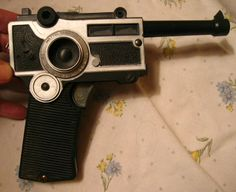 This was actually my older brothers but I still loved it.  It was a cap gun (remember those?) that would fold up to look like a camera.  Super spy kinda toy.