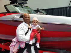 January 28th, 2017 At the car show in Portland Oregon.   Standing in front of a shiny boat with Daddy.