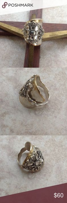 🆕👑👑Kings Cross Ring👑👑 This ring was made from a spoon from  Norway. Some of the brass underneath is showing thru which gives it a nice patina affect. I believe when making a ring from vintage silver the wear and markings give the ring personality. See the matching earrings Jewelry Rings