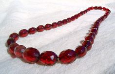 """Art Deco RED Cherry Amber Bakelite Necklace Faceted Oval Beads 22"""" Graduated Vintage by Oldtreasuretrunk on Etsy"""