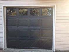 Our garage after- painted Valspar Fired Earth and removed panes from the windows.