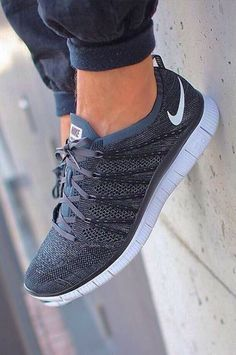 Gray and white Nike runners/trainers