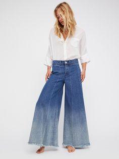 Run Through The Moss Wide Leg Jeans | Dramatic wide leg jeans in a high-rise silhouette.    * Lightweight rigid denim   * Front welt pockets   * Flat back   * Let down hem   * Button fly