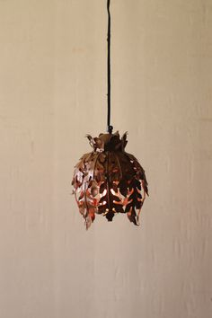 Rustic metal leaf pendant lamp. Available in 3 styles.