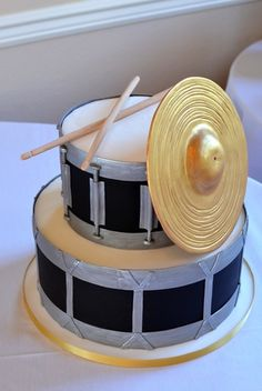 Drum Set Groom's Cake with Edible Drum Sticks and Sugar Cymbal Painted with Edible Gold. Image © Carla Niermann
