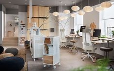 This small office is furnished with ergonomic IKEA JÄRVFJÄLLET swivel chairs, IVAR pine storage cabinets and BEKANT pine veneer work desks for a modern look. Bureau Design, Stair Storage, Office Storage, Ikea Under Stairs, Large Storage Units, Office Ceiling, Pine Cabinets, Small Space Office, Ikea Desk