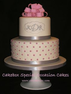 """simple 2 tiered cake on stand with pretty """"pintuck"""" pattern on bottom"""