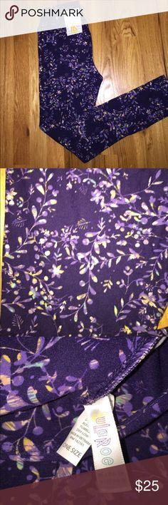LuLaRoe OS Leggings NWT Gorgeous dark purple leggings with lavender, pale yellow, pink and light blue flower print. Brand new with tags LuLaRoe Pants Leggings