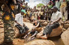 Baptism in a shallow stream.  Heidi Baker, Iris Ministries, Mozambique.  (from Christianity Today, May 2012)