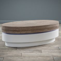 The Large Oval Mod Rotatable Coffee Table with Sonoma Top offers a clear late 60's vibe to any room it is placed in. With a rotating top this table is multifunctional and unique. Make a statement in your home with the Large Oval Mod Rotatable Table with Sonoma Top.Product Details:Includes: One (1) coffee tableMaterials: plywood with high gloss white and dark sonoma oak wood finishColor: glossy white and dark sonoma oak wood tonefinish: high gloss white and dark sonoma oak wood toneSome as...