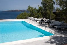 Each magnificent villa exudes the tranquillity and allure of a Cycladic oasis that has it all: sweeping views, sophisticated interiors, a spa and private swimming pool. Best Hotels In Santorini, Ambassador Hotel, Hotel Suites, Private Pool, Oasis, Swimming Pools, Villa, Spa, Interiors