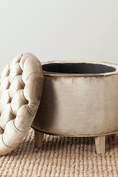 Amelia Tufted Storage Ottoman. I feel like I could hack this with an old tractor tire...