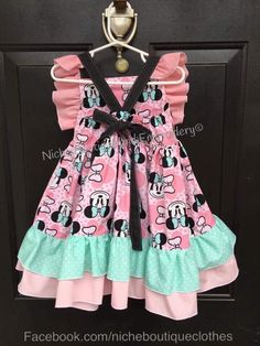 How amazing is this custom designed boutique style Minnie Mouse dress from Niche Boutique and Embroidery! You have to check her hand made clothing made right here in the USA! So many beautiful boutique style clothing for infants, children and women.