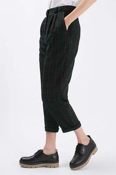 Take notes from the boys with these mensy-fit trousers. A relaxed silhouette with a focus on the turn-up hems, they feature a sleek all-over check design. #Topshop