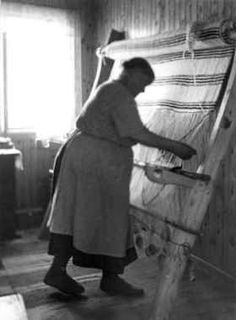 Anne Hansen | weaving a rug | Sámi greneveving: vertical warp-weighted weaving | Manndalen village, northern Norway | 1955 | Marta Hoffman: photographer