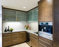 small kitchen furniture ideas walnut kitchen cabinets glass fronts under cabinet lighting Walnut Kitchen Cabinets, Glass Kitchen Cabinet Doors, Contemporary Kitchen Cabinets, Kitchen Cabinet Design, Glass Doors, Glass Cabinets, Kitchen Designs, Upper Cabinets, Wood Cabinets