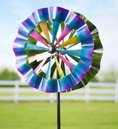Turn your landscape into a party with our Celebration Wind Spinner! With two opposite-spinning propellers, you're in for a magical show.