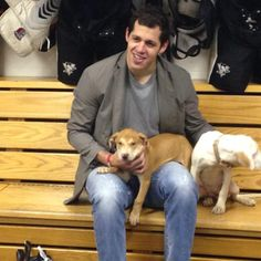 I will always repin/reblog boys with dogs. Evgeni Malkin with dogs: swoon.
