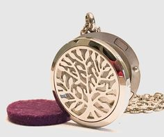 """What a great deal on this Tree of Life design diffuser necklace!  They usually cost at least twice this much!   hypo-allergenic 316L surgical stainless steel diffuser locket and 20"""" stainless steel chain for only 12 bucks with free shipping!!"""