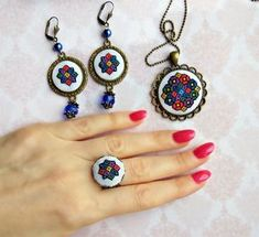 Micro embroidery Ukrainian ornament set of Necklace, Earrings and Ring, Ukrainian gift, Hand Embroidery, Gift for women, embroidered jewelry. Details This beautiful Ukrainian ornament set of Necklace, Earrings and Ring, with a hand cross stitch embroidered. A perfect accessory or