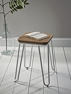 With a pale birch seat and slender hairpin legs, our elegant low stool will make a subtle industrial statement in your kitchen or dining room. A great alternative to a traditional dining chair, its minimalistic design will help to create a relaxing living space.