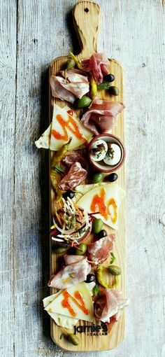 Jamie Oliver's antipasto plank. For crazy delicious video: https://m.youtube.com/watch?v=giwz66PcH4U