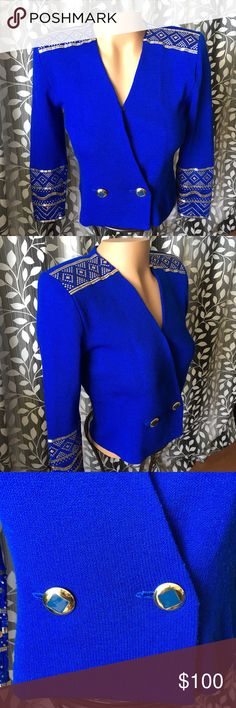 "St. John cropped Blazer double breasted gold decor Beautiful St. John Blazer! Cropped double breasted. Size 10. Armpit to armpit- 18.5"" shoulder to shoulder- 16.5"" neck to bottom- 23"" shoulder to sleeve bottom- 23"". There are gold and blue palleits decorations and a few of the blue have fallen off. Please see close up photos. Still a stunning Blazer! Thanks. St. John Jackets & Coats Blazers"
